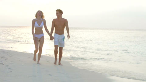 Romantic Couple Walking On Beautiful Tropical Beac Footage