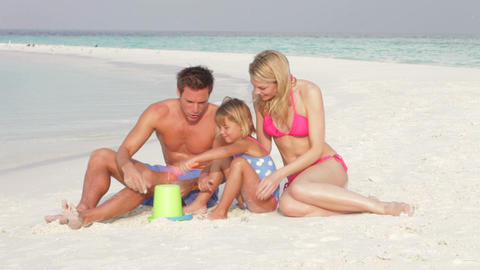 Family Making Sandcastle On Beach Holiday Footage