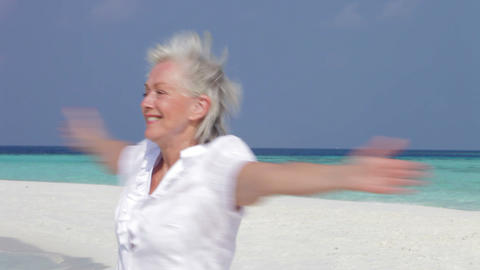 Senior Woman With Arms Outstretched On Beautiful B Footage