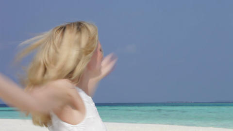 Woman With Arms Outstretched On Beautiful Beach Footage