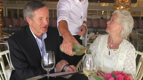 Senior Couple Enjoying Meal In Restaurant stock footage