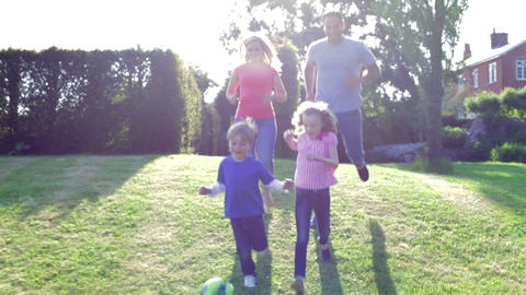 Family Playing Football In Garden Together Footage
