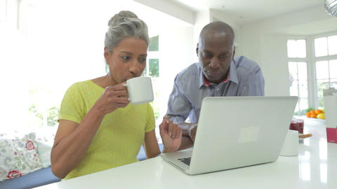 Mature African American Couple Using Laptop At Hom stock footage
