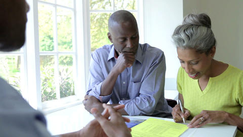 Mature Black Couple Meeting With Financial Advisor Footage
