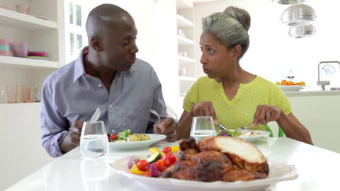 Mature African American Couple Eating Meal At Home stock footage