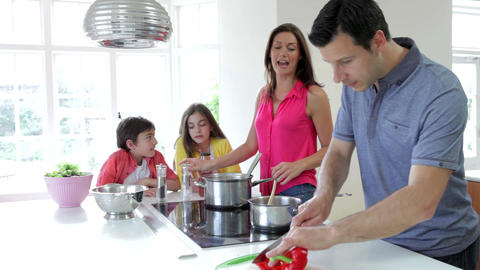 Hispanic Family Cooking Meal At Home Footage