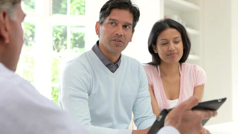 Indian Couple Meeting With Financial Advisor At Ho Footage