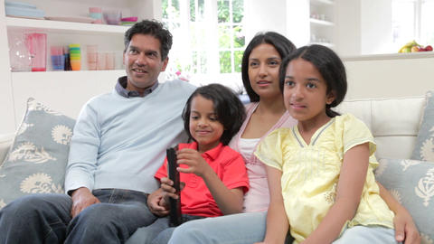 Indian Family Sitting On Sofa Watching TV Together Footage