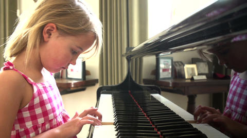 Young Girl Practicing Piano At Home Footage