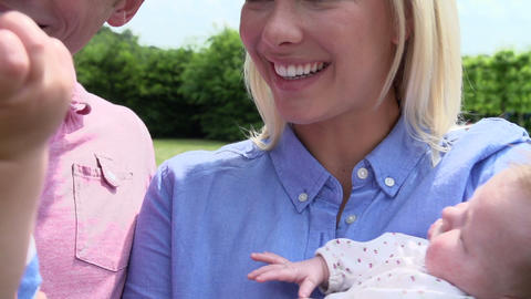 Slow Motion Shot Of Family With Baby Daughter In G Footage