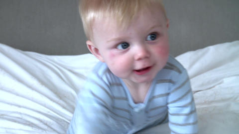 Young Baby Boy Playing In Bed Footage