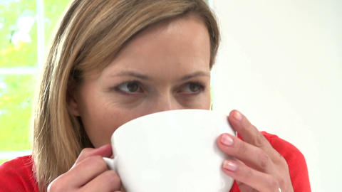 Woman Relaxing At Home With Hot Drink stock footage