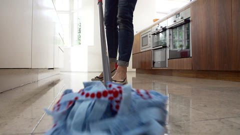 Slow Motion Sequence Of Woman Mopping Kitchen Floo Footage