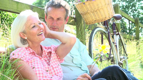 Middle Aged Couple Relaxing On Country Cycle Ride Live Action