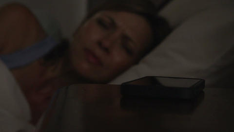 Middle Aged Couple In Bed With Woman Woken By Phon Footage