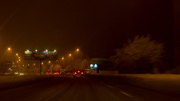 Night city. Winter. Snow-covered trees. Traffic through the city streets Footage