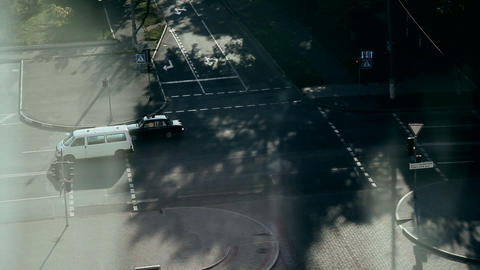 Morning. Road intersection. Slow movement of transport. Top view of the house Footage