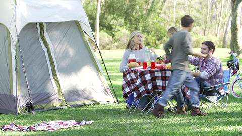 Family Enjoying Camping Holiday In Countryside Footage