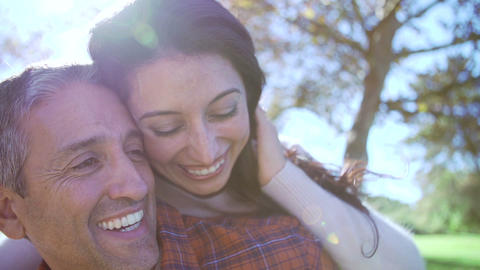 Slow Motion Sequence Of Man Giving Woman Piggyback stock footage