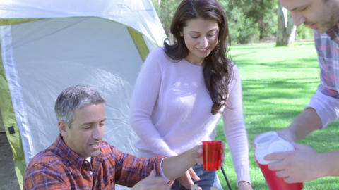 Two Families Enjoying Camping Holiday In Countryside Footage