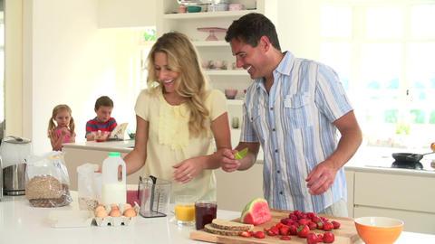 Parents Preparing Family Breakfast In Kitchen Footage