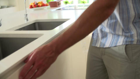 Slow Motion Sequence Of Man Recycling Kitchen Wast stock footage