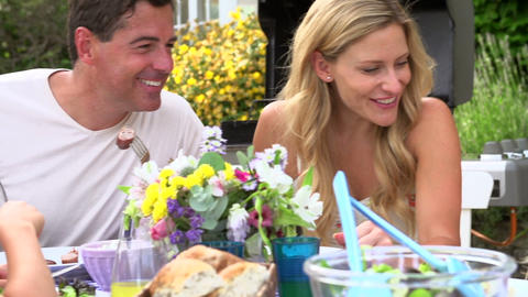 Family Enjoying Outdoor Meal In Garden Footage