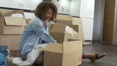 Woman Packing Boxes Ready For House Move Footage