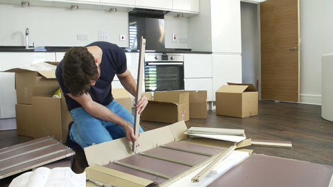 Man Putting Together Self Assembly Furniture In Ne Stock Video Footage