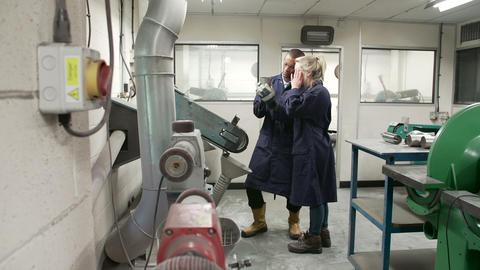 Engineer Teaching Apprentice To Use Grinding Machi Footage
