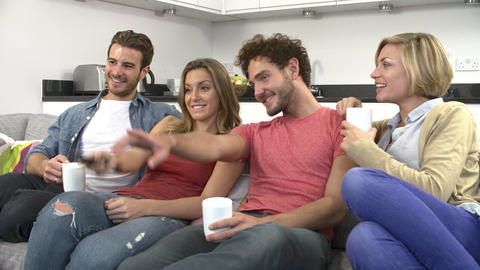 Group Of Friends Watching Television Together At H Footage