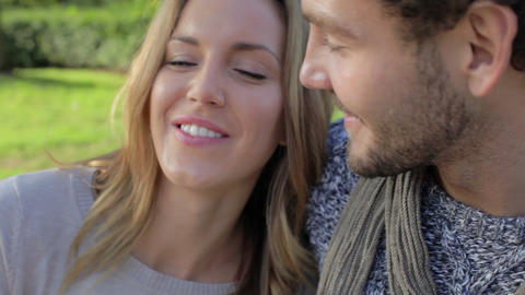 Couple Relaxing On Park Bench With Takeaway Coffee Footage