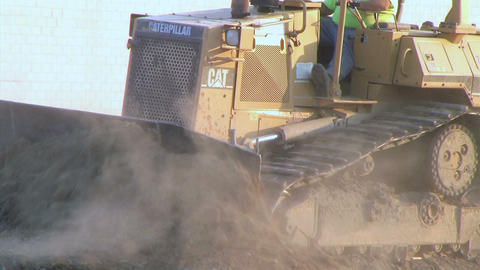 Dozer Clears Edge of Road Stock Video Footage