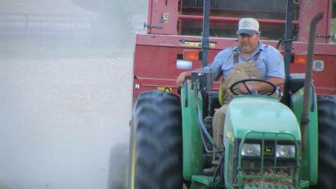 Farmer Baling Hay Stock Video Footage