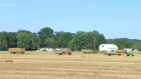 Farmer Square Baling Hay 02 Stock Video Footage