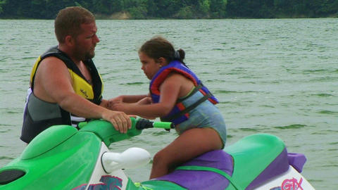 Daughter Getting Off Jet Ski Stock Video Footage