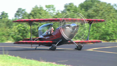 Biplane Taxiing with Smoke Stock Video Footage