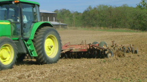 Tractor Discing Field Stock Video Footage