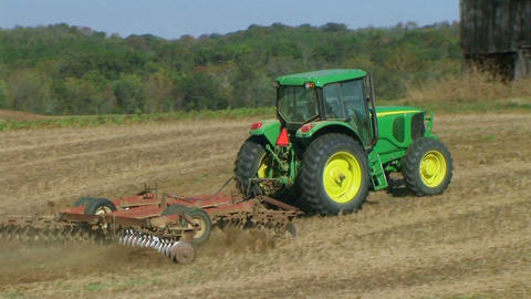 Tractor Discing Field 02 Stock Video Footage