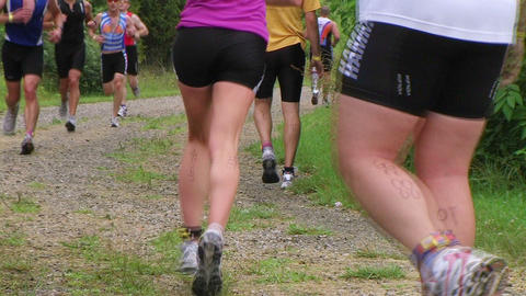 Runners Jogging In Race Stock Video Footage
