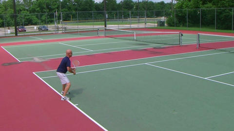 Tennis Player Volleys Stock Video Footage