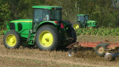 Tractors Discing And Sowing Field Stock Video Footage
