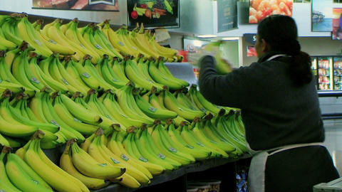 Woman Stocking Bananas Stock Video Footage