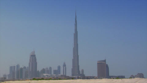 Dubai skyline pan burj emirates dune Stock Video Footage