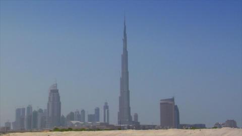 Dubai skyline pan burj emirates dune Footage