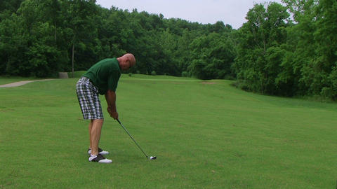 Golfer Hitting Ball With Iron Stock Video Footage