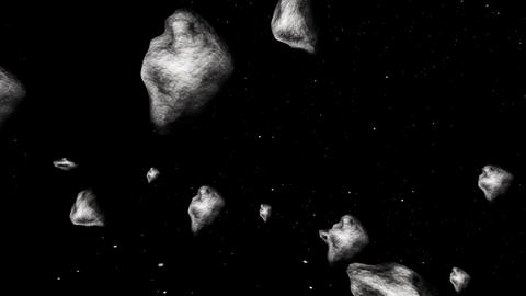 At the middle of hundreds asteroids in 3D space Stock Video Footage