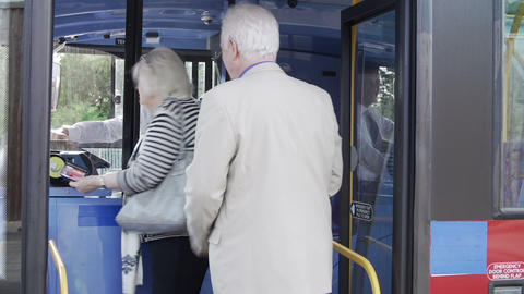 Senior Couple Boarding Bus And Using Pass stock footage