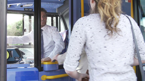 Passengers Boarding Bus Using Passes And Buying Ti Footage