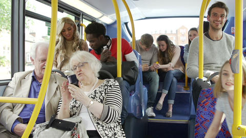 Passengers Using Mobile Devices On Bus Journey stock footage